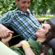 Girlfriend resting head on boyfriend's lap — Stock Photo #3831327