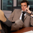 Royalty-Free Stock Photo: Businessman talking on telephone in an office