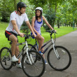 Stock Photo: Young couple on bike trip