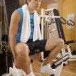 Stock Photo: Portrait of young mtaking rest in gym