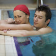 Couple in swimming pool - Stock Photo