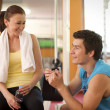 Royalty-Free Stock Photo: Man and Woman Talking in Health Club
