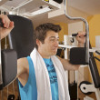 A young man exercising at gym - ストック写真
