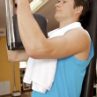 A young man exercising at gym - Foto de Stock