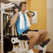 A young man exercising at gym - Photo