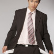 Young caucasian businessman showing his empty pockets — Stock Photo