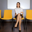 Stock Photo: Portrait of businesswomsitting in waiting room