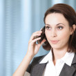 Portrait of young caucasian businesswoman talking on cellphone — Stock Photo