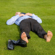 Businessman relaxing in park — Stock Photo