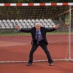Businessman defending goal — Stock Photo #3839238