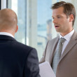 Stock Photo: Close-up of businessmen conversing