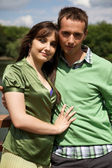 Portrait of young couple with arm around — Stock Photo