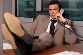 Businessman talking on telephone in an office — Stock Photo