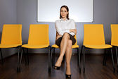Portrait of businesswoman sitting in waiting room — Stock Photo