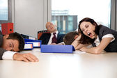 Young business team exchausted and over worked — Foto de Stock