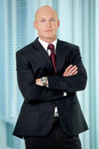 Portrait of young caucasian businessman in office — Stock Photo