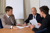 Businessmen in meeting at board room — Stock Photo