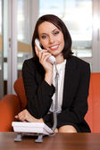 Businesswoman conversing on landline phone, portrait — Foto Stock