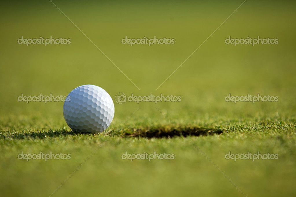 Golf ball near hole  Stock Photo #3830107