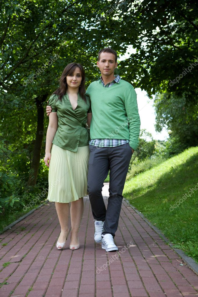 Young couple walking in park — Stock Photo #3831802