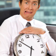 Portrait of businessman holding clock — Stock Photo #3840276