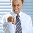 Portrait of businessman shouting in office — Stock Photo