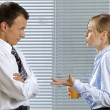 Stock Photo: Businessmand womin conversation at office