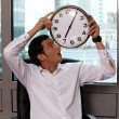 Businessman looking at clock in office — Stock Photo