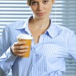 Portrait of businesswoman holding glass of coffee — Stock Photo