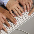 Human hands using computer keyboard — Stock Photo