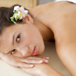 Close-up of young woman relaxing on massage table — Stock Photo