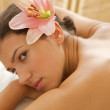 Portrait of young woman relaxing on massage table — Stock Photo #3840825