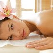 Portrait of young woman relaxing on massage table — Stock Photo