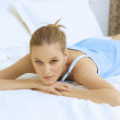 Woman Relaxing on bed — Stock Photo #3841024