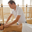 Young woman receiving massage — Stock Photo
