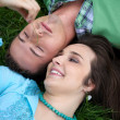 Young couple lying on grass — Stock Photo #3841633