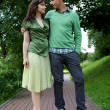 Young couple posing at park — Stock Photo