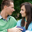 Stock Photo: View of young couple face to face