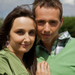 Portrait of young couple smiling — Stock Photo
