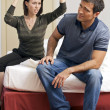 Stock Photo: Young arguing with her husband in hotel room