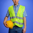 Portrait of architect in coveralls holding hardhat — Stock Photo
