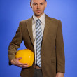 Portrait of businessman holding hardhat — Stock Photo