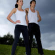 Young couple exercising in park — Stock Photo #3844708