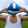 Young man with valleyball in park — Stock Photo #3844731