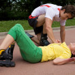 Skater injured and clutching arm — Stock Photo #3844745