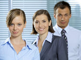 Portrait of businessman and businesswomen smiling in office — Stock Photo