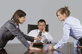 Businesswomen arguing in front of businessman at office — Stock Photo