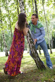 Young couple looking at each other in park — Stock Photo
