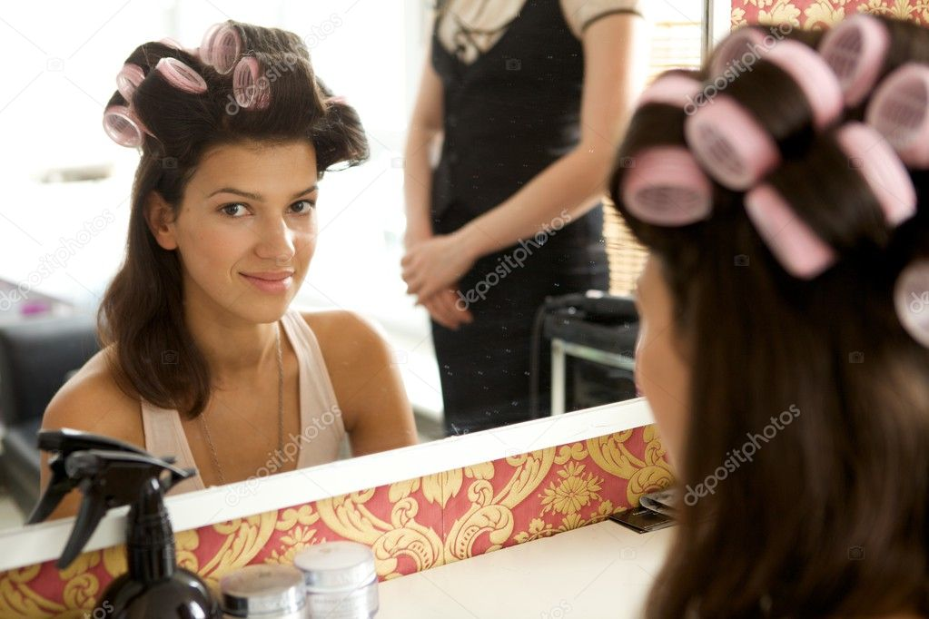 Portrait of young woman with hair curlers smiling  Stock Photo #3840986