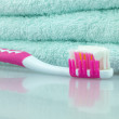 Stock Photo: Towels and toothbrushes